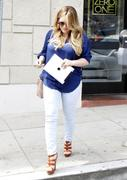 http://img166.imagevenue.com/loc523/th_313015852_Hilary_Duff_at_hair_salon_in_Beverly_Hills27_122_523lo.jpg